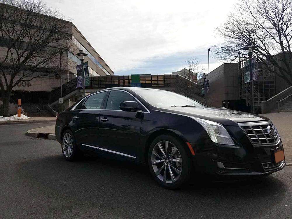 https://yorkieslimos.com/Cadillac%20XTS